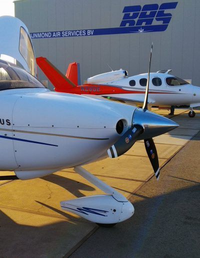 Cirrus SR20 from the side with VisionJet in background